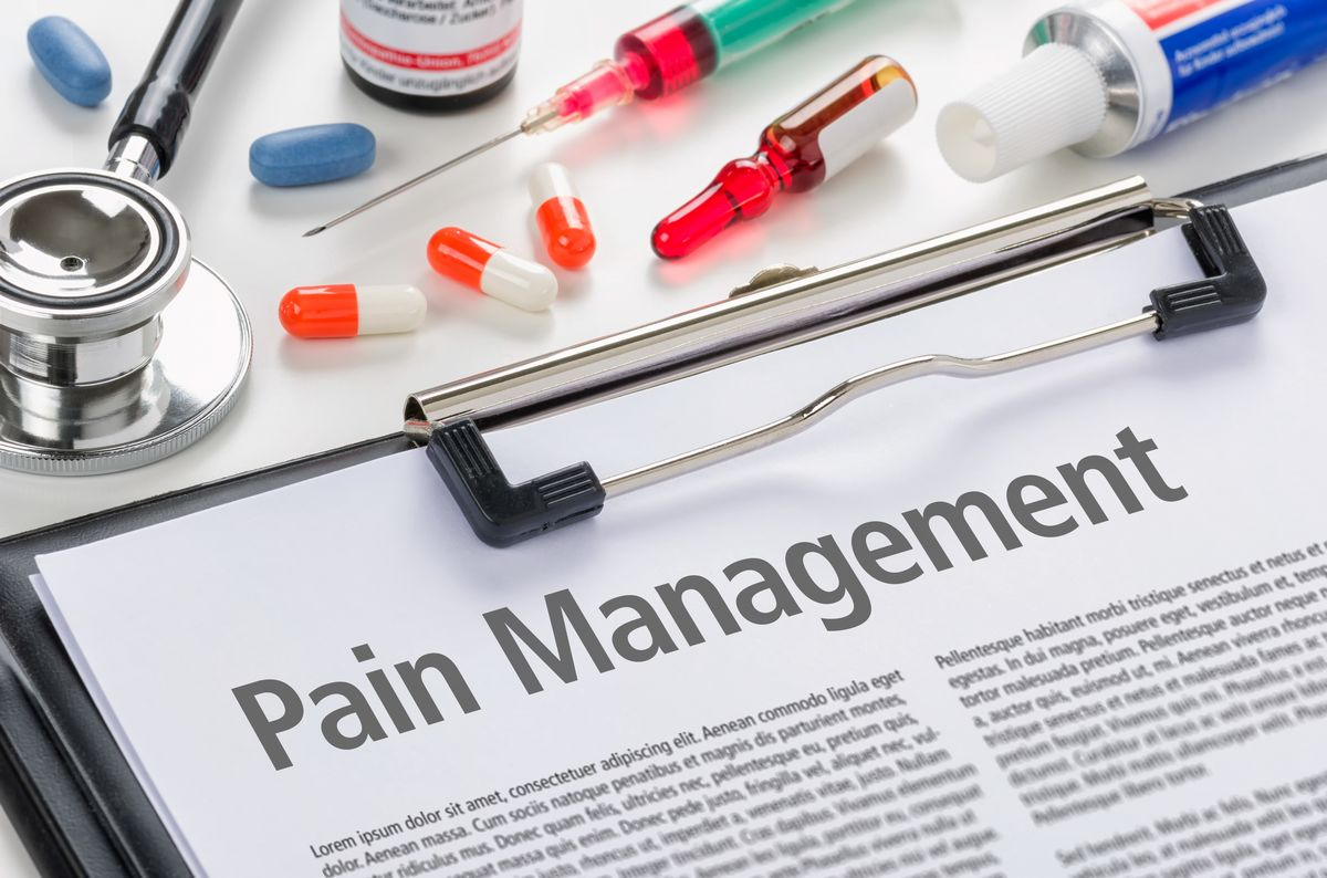 Pain Management written on a clipboard